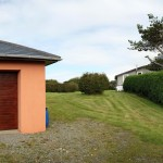 10-panoramic view of garage and house